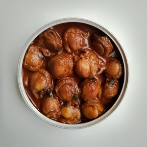 Small scallops in scallop sauce